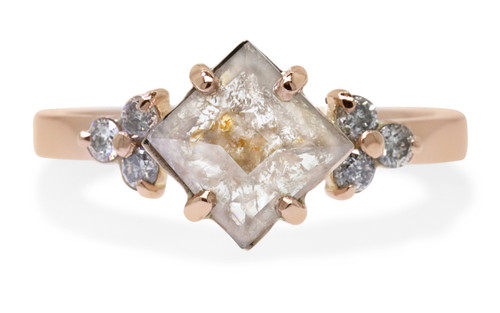 1.20 carat square, rose-cut light gray and peach prong set diamond ring with six 2mm brilliant gray diamond clusters on either side of main setting set in 14k rose gold flat band. Front view on white background