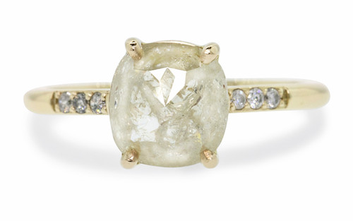 1.43 carat cushion, rose-cut light cream prong set diamond ring set in 14k yellow gold with six 1.2mm brilliant gray diamonds set into 1/2 round band. Front view on white background