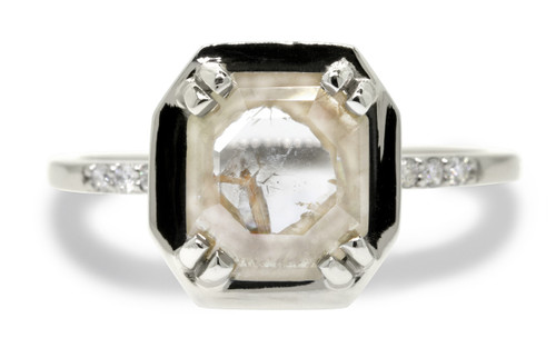 MAROA 1.29 carat fancy, rose-cut beige and rustic white set in our signature square setting diamond ring set in 14k white gold. With ten 1.2mm brilliant white diamonds set in notched band and each corner of main setting. Part of our New Classic Collection. Front view on white background