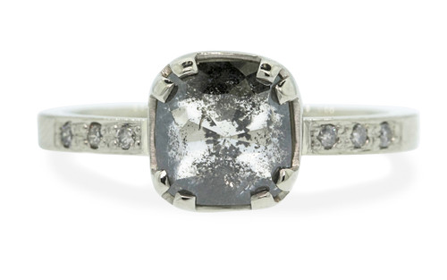 1.62 carat cushion, rose cut salt and pepper diamond prong/bezel set diamond ring set in 14k white gold with six 1.2mm brilliant gray diamonds set in flat band. Front view on white background