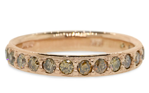 14k rose gold wedding band with 16 brilliant champagne pave diamonds half way around band. On white back ground.