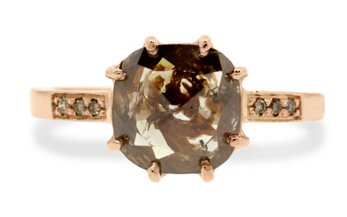 2.28 carat cushion, rose cut translucent rustic cognac prong set diamond ring set in 14k rose gold with six 1.2mm brilliant champagne diamonds set in flat band. Front view on white background
