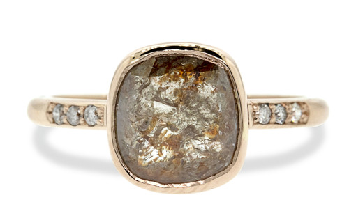 2.35 carat one of a kind cushion rose cut gorgeous, natural, rustic cognac bezel set diamond ring with six 1.2mm brilliant champagne diamonds bead set into 14k recycled rose 2mm 1/2 round gold band. Front view on white background.