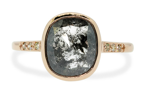 """2.64 carats One of a kind, gorgeous, natural, cushion, rose cut """"salt and pepper"""" diamond. Bezel set in 14k recycled rose gold 1/2 round band with six 1.2mm brilliant champagne diamonds bead set into band. Front view on white background"""