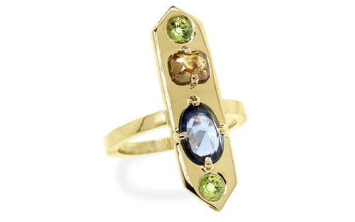 Our Santorini pieces feature a combination of gemstones and diamonds - each highlighting the other. One of a kind, this ring features a .87 carat sapphire, a .43 carat vibrant orange diamond and a pair of 3mm demantoid garnets. free-form, rose cut sapphire, cushion, rose cut orange diamond. 14k recycled yellow gold. Part of our New Classic Collection. 3/4 view on white background.