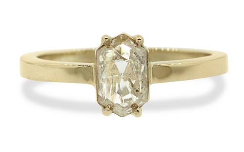 One of a kind, this .67ct diamond has a sparkling and translucent, light champagne color. hexagonal, fancy, rose cut diamond that measures 8mm x 5.25mm. 14k recycled yellow gold with a band that measures 2mm wide. Front view on white background.