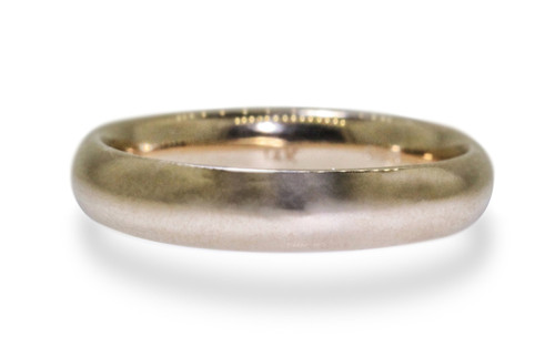 14k yellow gold mens wedding band on white back ground.