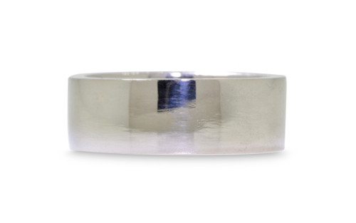 8mm wide flat wedding band in 14k white gold.  Polished finish.  White background.