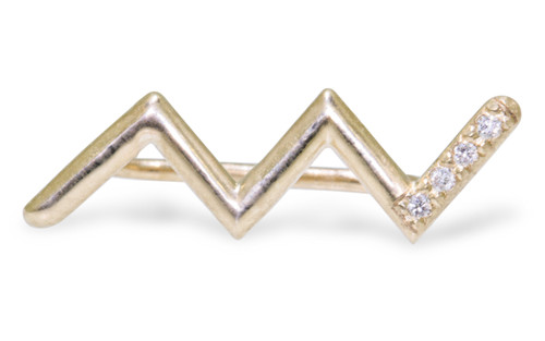 Ear climber in zig zag shape in 14k yellow gold.  Small brilliant round white diamonds are set in last section of the earring.  Front view of one earring on white background.