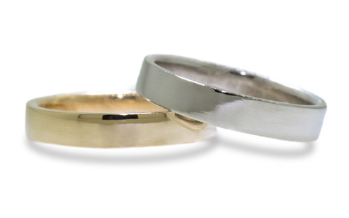 14k yellow gold women's flat wedding band.  14k white gold women's flat wedding band on white background