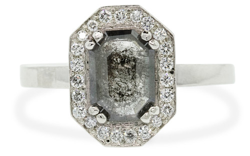 KATLA .66 carat fancy cut salt and pepper diamond prong set in octagon 14k white gold setting with brilliant, white diamonds surround the center diamond in a halo as well as each corner of the setting and each shoulder of the ring.
