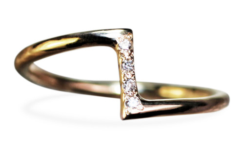 14k yellow gold ring in a zig-zag shape.  Small, brilliant white diamonds are set in the center bar of the ring.  Front view on white background.