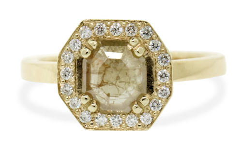 KATLA .57 carat octagon cut light peach diamond prong set in octagon  14k yellow gold setting with brilliant, white diamonds surround the center diamond in a halo as well as each corner of the setting and each shoulder of the ring. New Classic