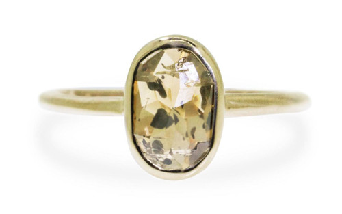 2.23 carat oval, rose cut champagne and pepper bezel set diamond ring set in 14k yellow gold 1/2 round band. Front view on white background