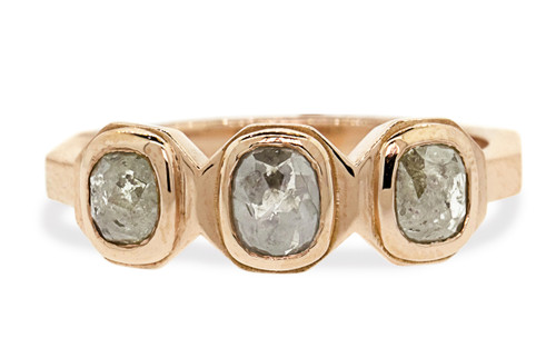 14k rose gold ring with three gray rose cut diamonds bezel set in a rose.  The shape of each setting is octagonal.  Front view white background.