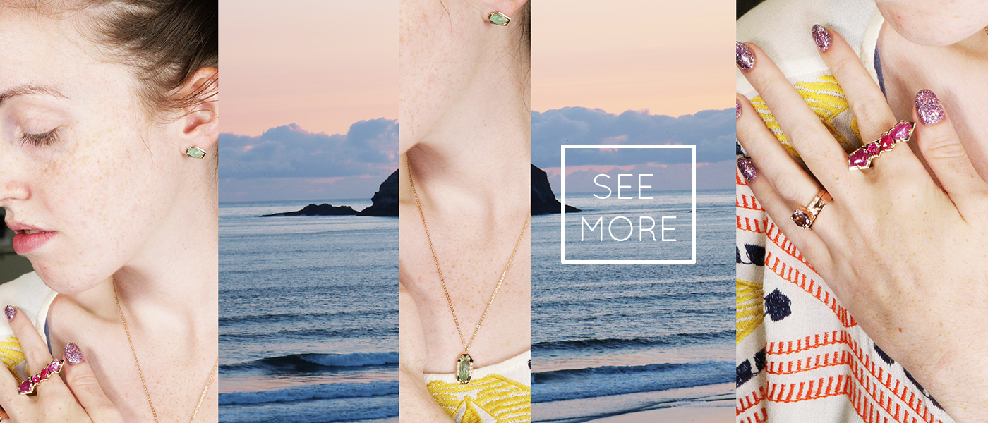 beautiful woman wearing ruby ring, morganite ring emerald earrings.  Ocean in the background.