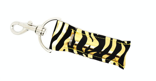 Black with Gold Foil Zebra Print    This lip balms holder is very durable with a stainless steel hook that is easily attached and unattached to a purse, keys, backpack, or lanyard.