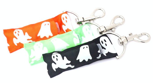 Ghost lip balm holder **Ghosts glow in the dark!  This lip balms holder is very durable with a stainless steel hook that is easily attached and unattached to a purse, keys, backpack, or lanyard.  3 Colors available: Black, Orange, Green. The Ghosts on this lip balm holder Glow in the Dark!