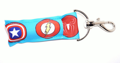 Superhero Lip balm Holder blue with circle logo's  This lip balms holder is very durable with a stainless steel hook that is easily attached and unattached to a purse, keys, backpack, or lanyard. This lip balm holder has multiple Superhero logo's .     Superhero logos on this holder:  Spiderman  Superman  Green Lantern  Captain America  Flash  Batman  MADE IN THE USA!!
