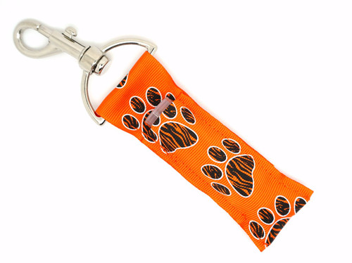 Orange with Black Zebra print Paw prints Lip Balm Holder   This lip balms holder is very durable with a stainless steel hook that is easily attached and unattached to a purse, keys, backpack, or lanyard. This lip balm holder has is Orange with black zebra paw prints with a white outline!  MADE IN THE USA!!