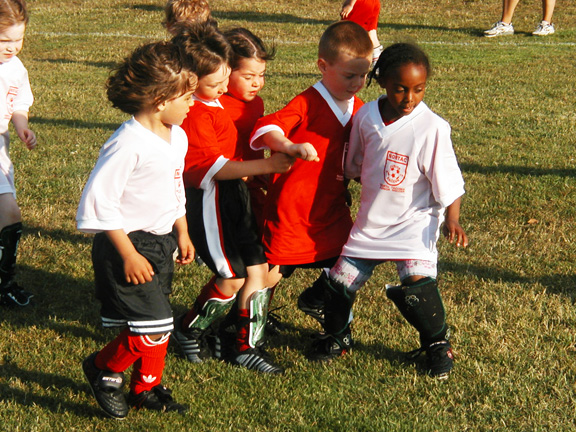 Young soccer players wearing the Code Four Athletics reversible soccer jersey.