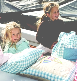 girls-in-boat-with-cushions.jpg