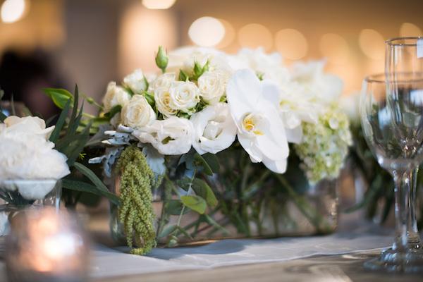 white wedding reception centrepiece roses orchid hydrangea