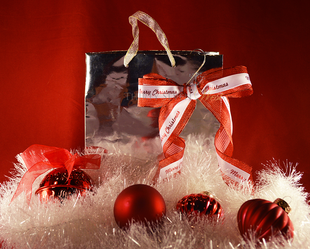 Ideas for gift wrapping using a gift bag and personalized customized printed ribbon.