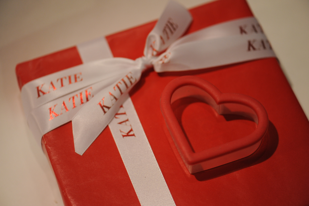 Personalized printed white satin ribbon with metallic red name printed on it