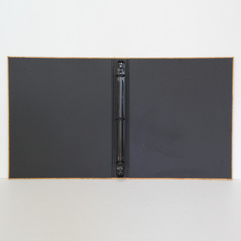 """Interior of Cork Three Ring Binder with 1/2"""" black three ring mechanism and linen black material."""