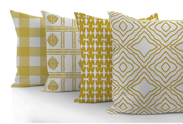 custom pillows featuring bold fabrics by Amy Moore