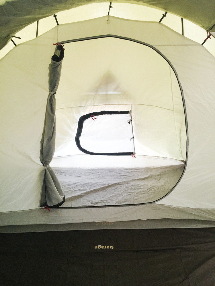 View of Redverz Solo Sleeping Area from Garage. Inner Sleeping tent has 2 entry doors from inside garage and out side tent. Both doors have privacy and mosquito screens.