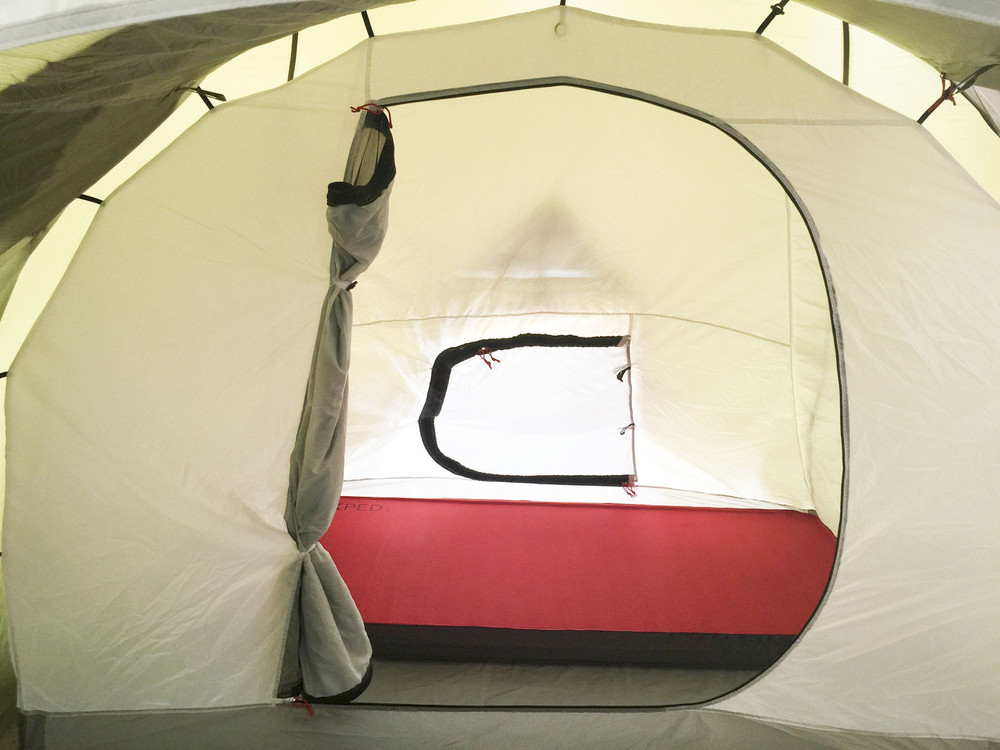 "Solo Sleeping showing 30"" wide Megamat 10. Inner Sleeping tent has 2 entry doors from inside garage and out side tent. Both doors have privacy and mosquito screens."
