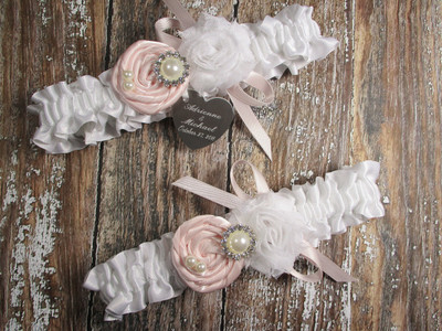 Personalized White Satin Wedding Garter Set Shown with Pink Blush Roses and Bows
