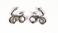 Single Rider Sterling Silver Earrings by Lucy Golden