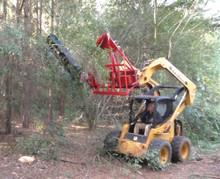 Trailblazer sawing tree limbs