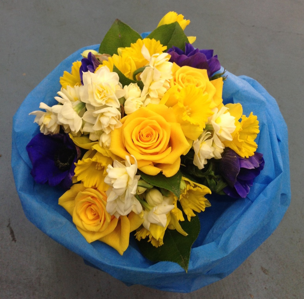 Seasonal bouquet in blues and yellows