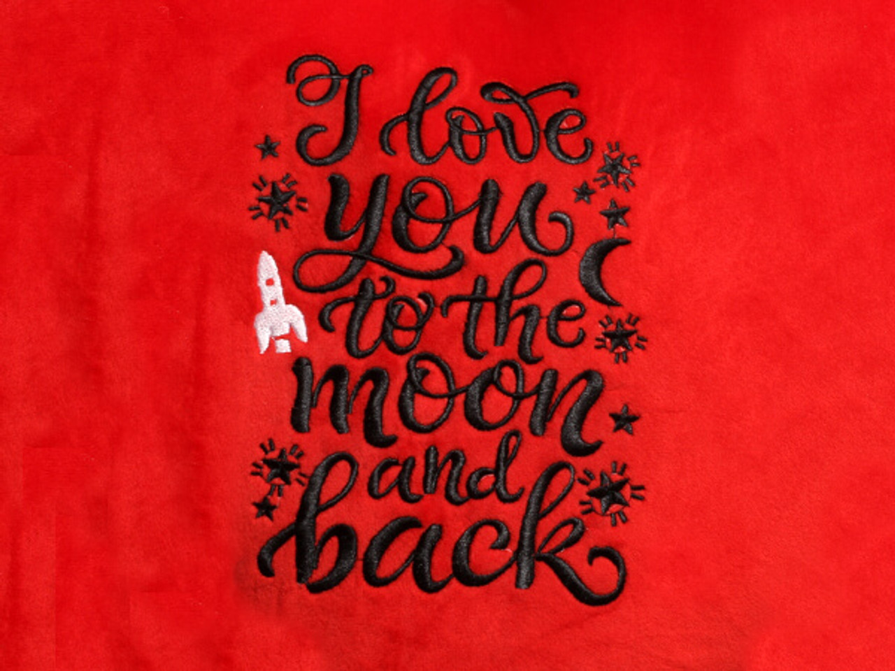 18in red heart pillow black embroidery 'I Love You to the Moon and Back' text close-up