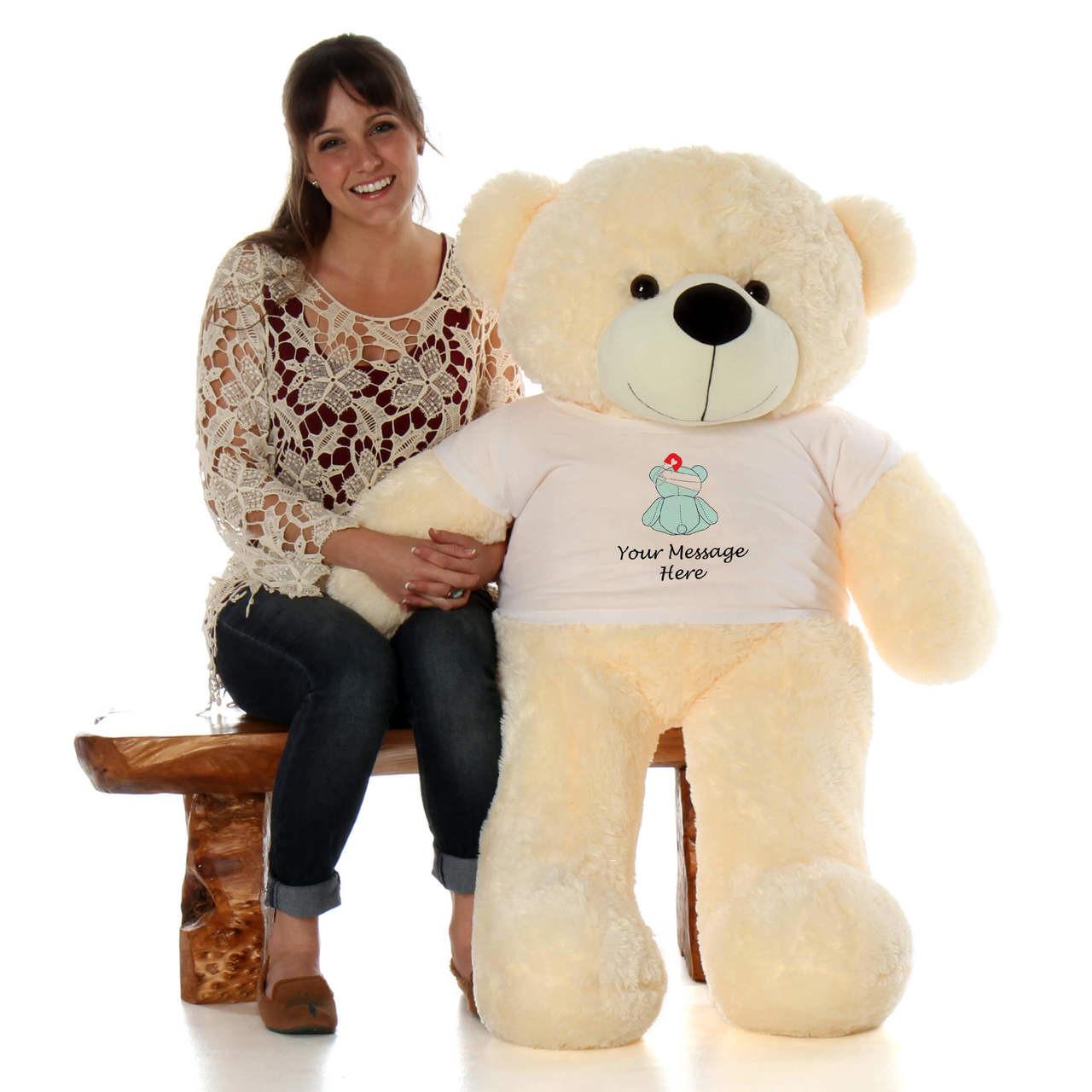 48in Vanilla Cozy Cuddles in personalized blue teddy bear in bandage shirt