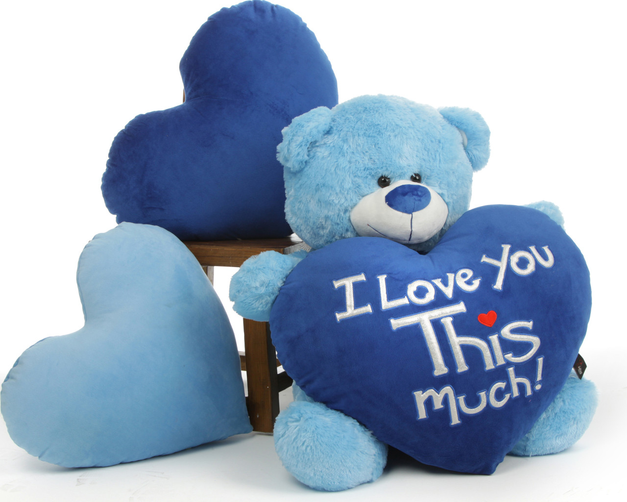 "Marty Shags is a sweet light blue bear with a huge ""I Love You This Much!"" royal blue plush heart – 35in"