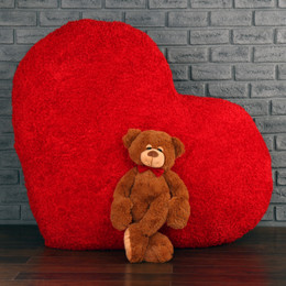 Adorable big chestnut Chester Mittens and giant red Heart Body Pillow