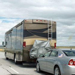 RV motorhome towing a car