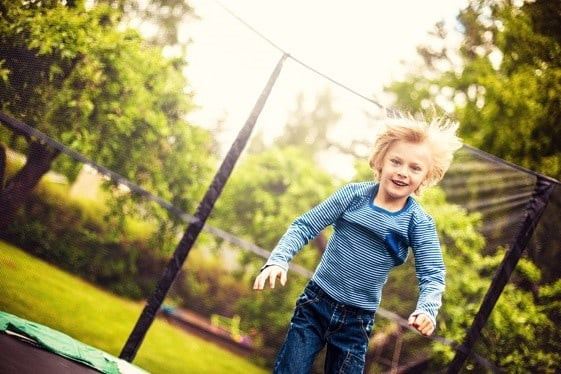 What's the Best Age to Start on a Backyard Trampoline? Experts Say Age 6.