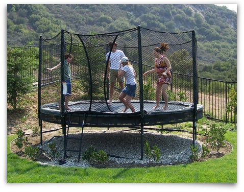 Family having fun on an AlleyOOP DoubleBounce Trampoline