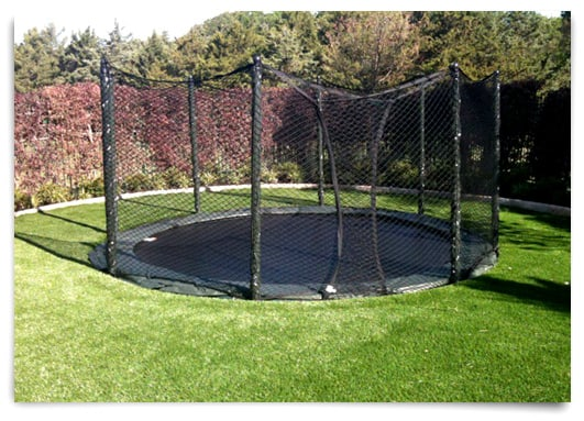 AlleyOOP in-ground trampoline surrounded by grass