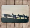 Equestrian or western themed bath mat with horses at the pasture fence.