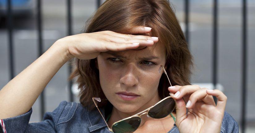 Woman with ADHD light sensitivity, photophobia