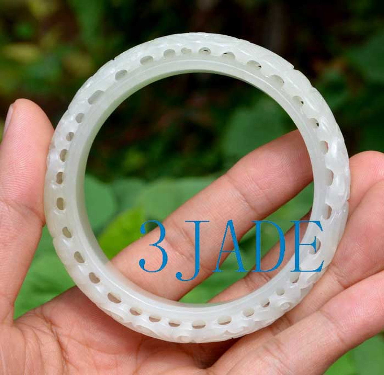 carved white jade bangle