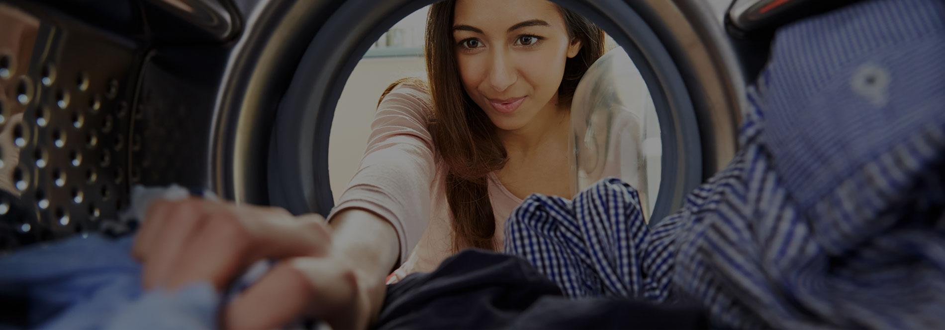 Women and washing machine