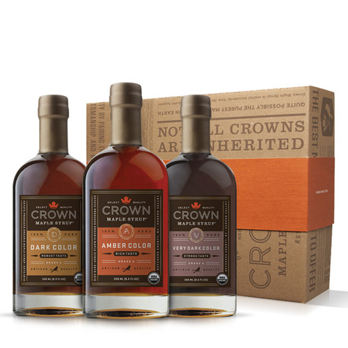 Make an uncommon impression with this distinctive Crown Maple Classic Trio Collection presented in an elegant Royal Treatment box with your choice of our signature classic orange band or HAPPY HOLIDAYS band.  Explore our classic, organic, 100% pure maple syrup sample collection featuring one 250ML (8.5 FL OZ) bottle each of Amber Color Rich Taste organic maple syrup, Dark Color Robust Taste organic maple syrup, and Very Dark Color Strong Taste organic maple syrup.  Discover the versatility of our classic, organic, 100% pure maple syrups and discover new, favorite ways to use each unique taste profile. Perhaps you'll use Amber Color Rich Taste to drizzle over a warm dessert or fresh fruit, or Dark Color Robust Taste for baking, pancakes and vinaigrettes.  Maybe you'll become hooked on Very Dark Color Strong Taste as a more flavorful and healthier sweetener for your coffee or tea, to drizzle over oatmeal or yogurt, or as a premium replacement for simple syrup in cocktails.